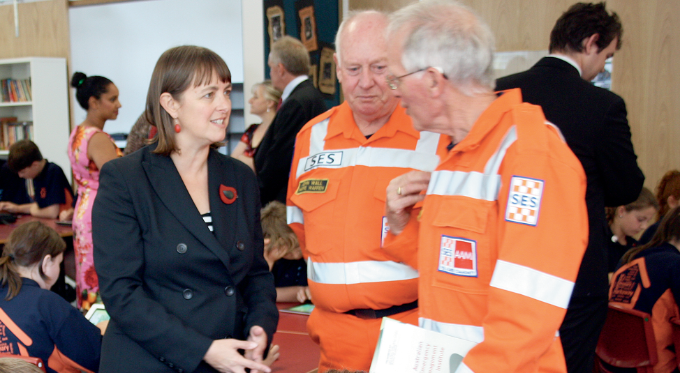 Photograph of the Hon Nicola Roxon with emergency services volunteers in uniforms at a primary school