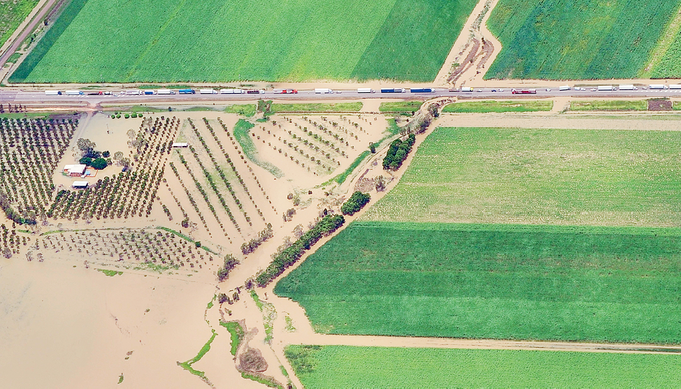 Aerial photograph of fields and a road showing traffic