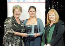 Photograph of Angela Forrest receiving her Young Planner of the Year award with Dyan Currie and Raelene Thompson