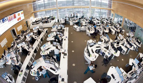 Top-view photograph of the Queensland Emergency Operations Centre showing the layout of workstations
