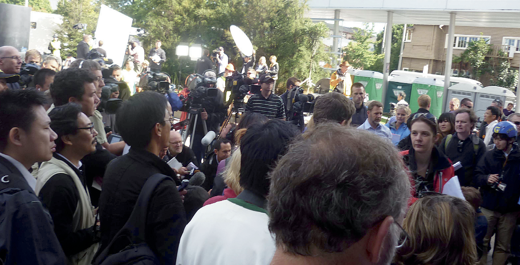 Photograph of a crowd of media personnel