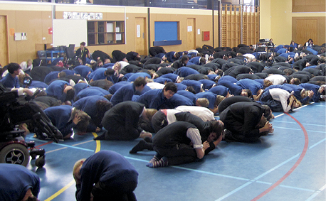 Photograph of schoolchildren crouching with heads down during the drill