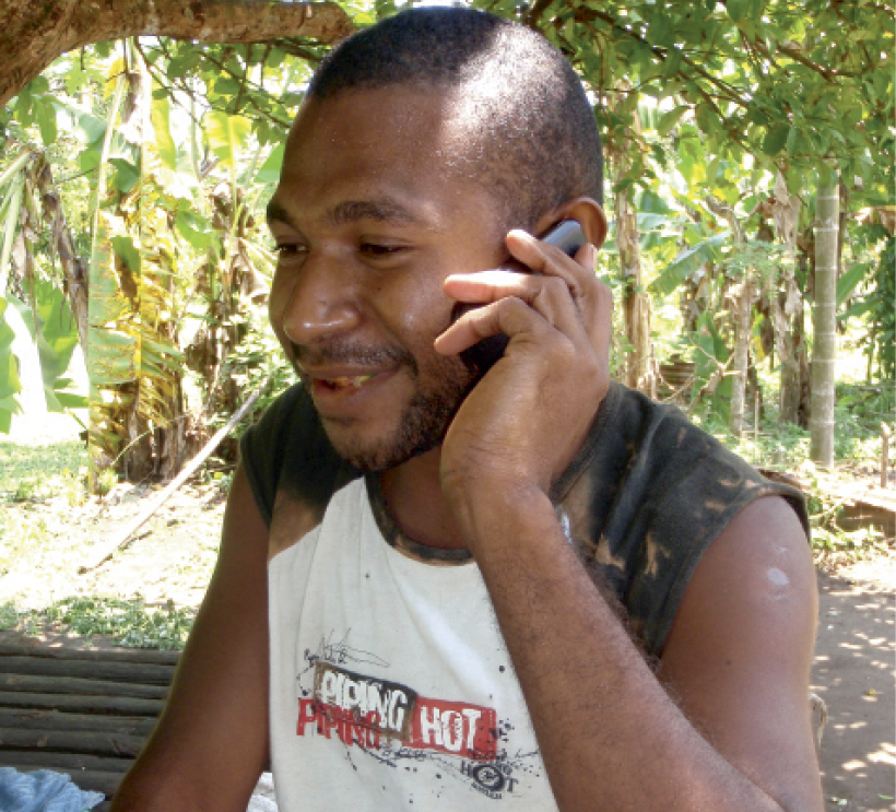 Photograph of a young man talking on a mobile phone