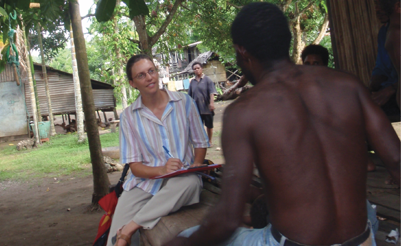 Photograph of Amanda Watson talking to a Megiar resident