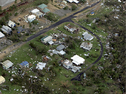 Aerial view of a residential area showing scattered debris.