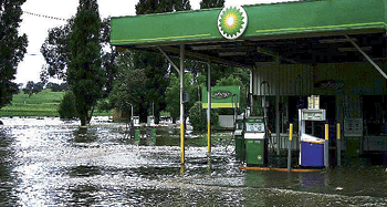 A BP petrol station inundated by floodwaters.