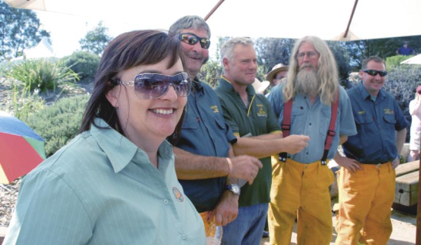 Mel Richers, Mike McColl, Simon Katz, Pat Barling and Matt Dutkiewicz dressed in firefighting overalls.