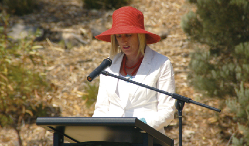 Katy Gallagher speaking from a lectern in an outdoor setting.