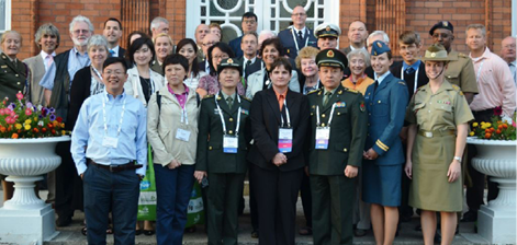 A photo of the pharmacists (about 35) standing in front of a building. Some are in their military uniforms.