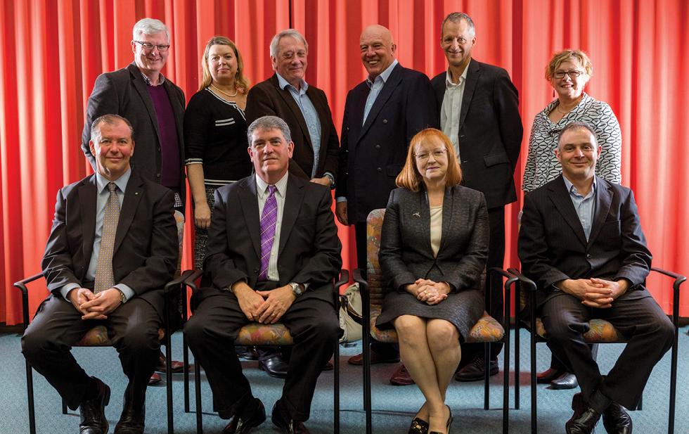 Ten men and women in business attire.