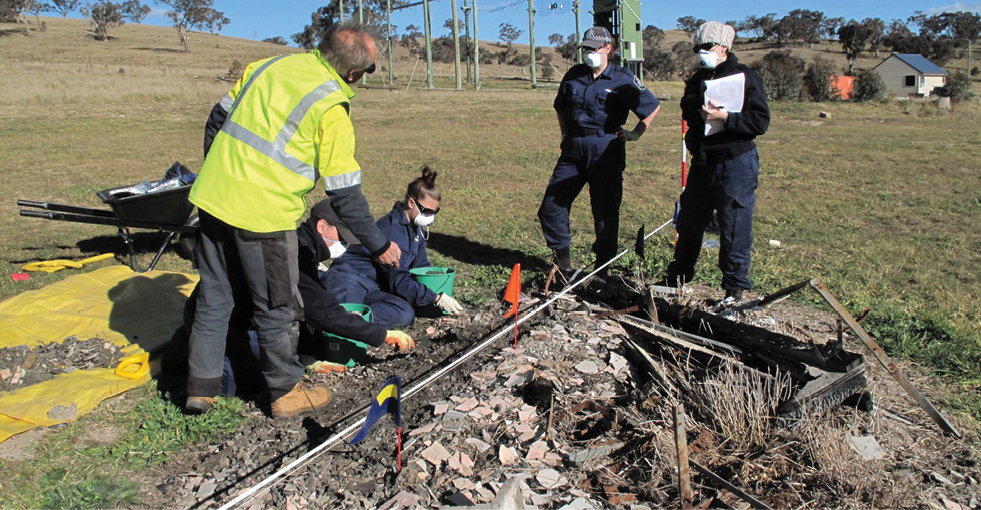 One person is instructing four others at a sample bushfire site.