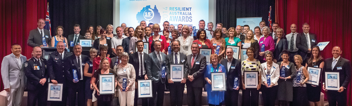 All 2014 Resilient Australia Award winners. A large group of people holding framed certificates.