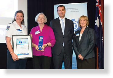 A photo of Hon. Michael Keenan MP with award winners Elizabeth Raines, Kathleen Oakes and Kim Gow