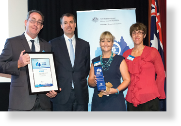 A photo of Hon. Michael Keenan MP with award winners Alan Bowmaker, Selina Taggart and Veronica Geiger