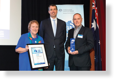 A photo of Hon. Michael Keenan MP with award winners Sandra Slatter and Anthony Turner