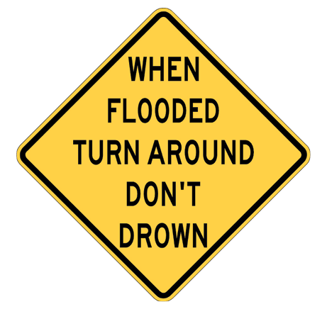 A yellow diamond road sign says 'When flooded turn around don't drown'