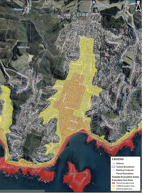 A satellite image of Island Bay, Wellington, New Zealand. The evacuation zones are highest along the water and include an island. Lower-level evacuation zones sit behind the high-level zones along the water, but also extend down the centre of the town.