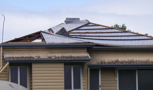 Photo of a home with missing roof cladding.