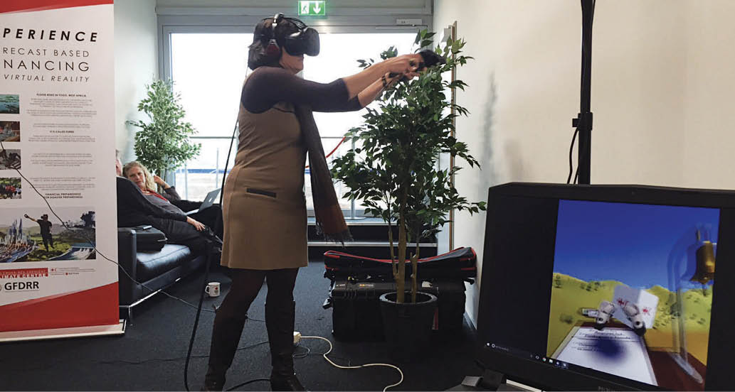 A photo of someone wearing goggles and using the virtual reality computer program.